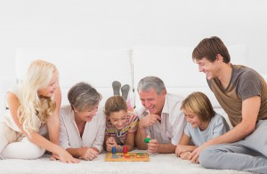 bigstock-Family-playing-board-games-in--44263408